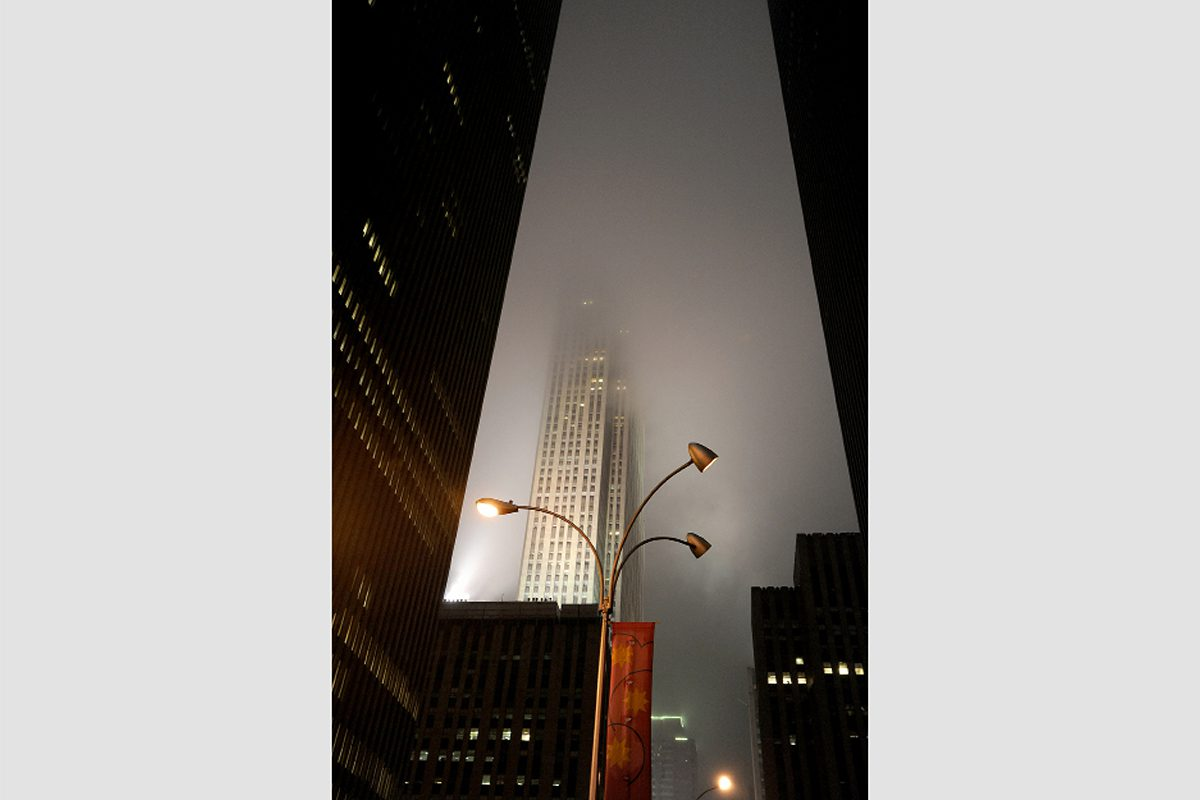 Skyscraper at night through mist and drizzle, Manhattan, 2011. Photograph by David Rowley