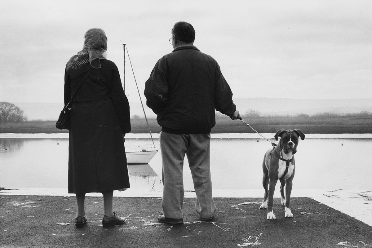 A couple out for a stroll with their dog on New Year's Day, Topsham, Devon, 2000. Photograph by David Rowley